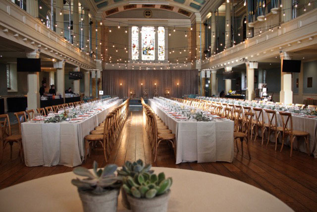 banquet style dining with festoons and succulents
