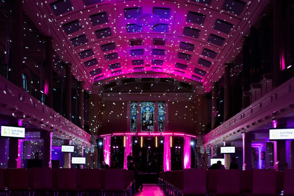 Pink event lighting with Gobos for strictly come dancing style event at St Mary's Venue Hire London