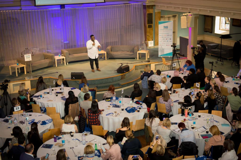speaker giving presentation from stage at a conference at St Mary's Venue Hire, LondonSt Mary's Venue Hire, London