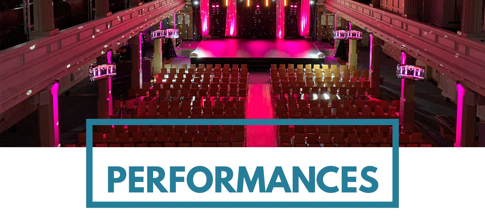 600 theatre style performance with pink event lighting at St Mary's Venue Hire, London