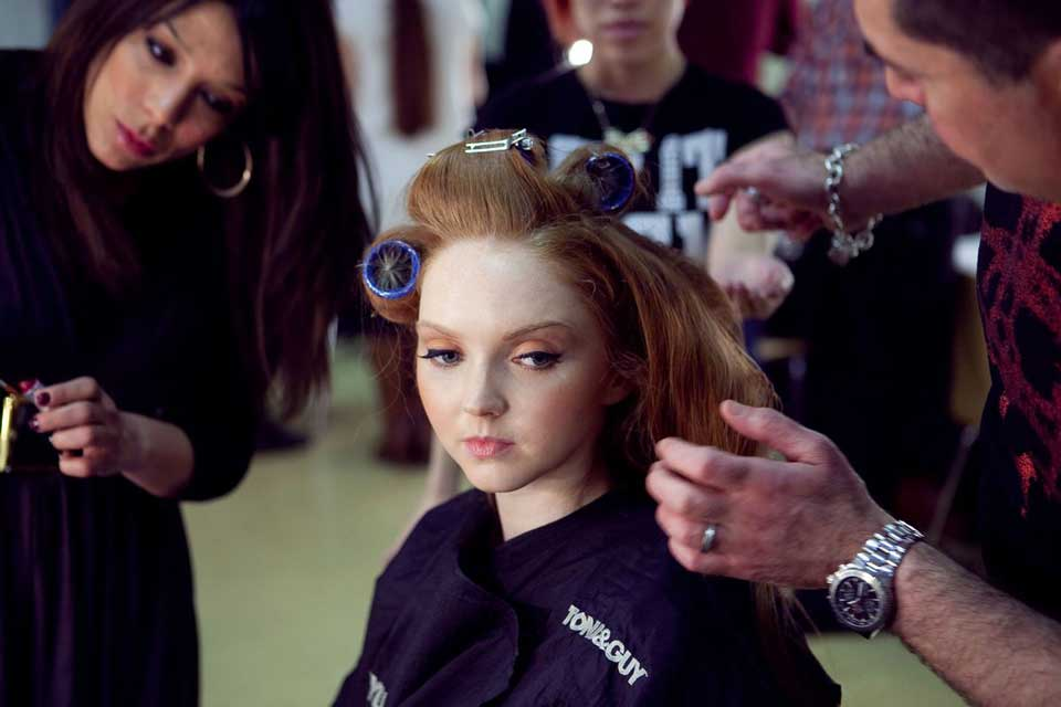 Lily Cole getting her hair styled by Toni & Guy for fashion show at Conference with screens and sofa style seating at St Mary's Venue Hire, London