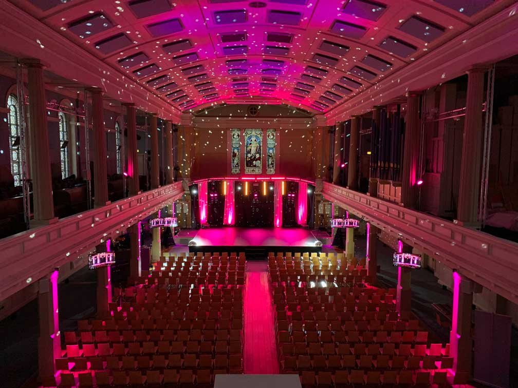 Dancing Competition with built out stage and pink event lighting