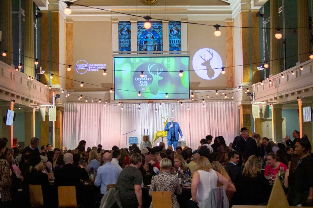 Pub Quiz with Greg Davies for Centre Point at Conference with screens and sofa style seating at St Mary's Venue Hire, London