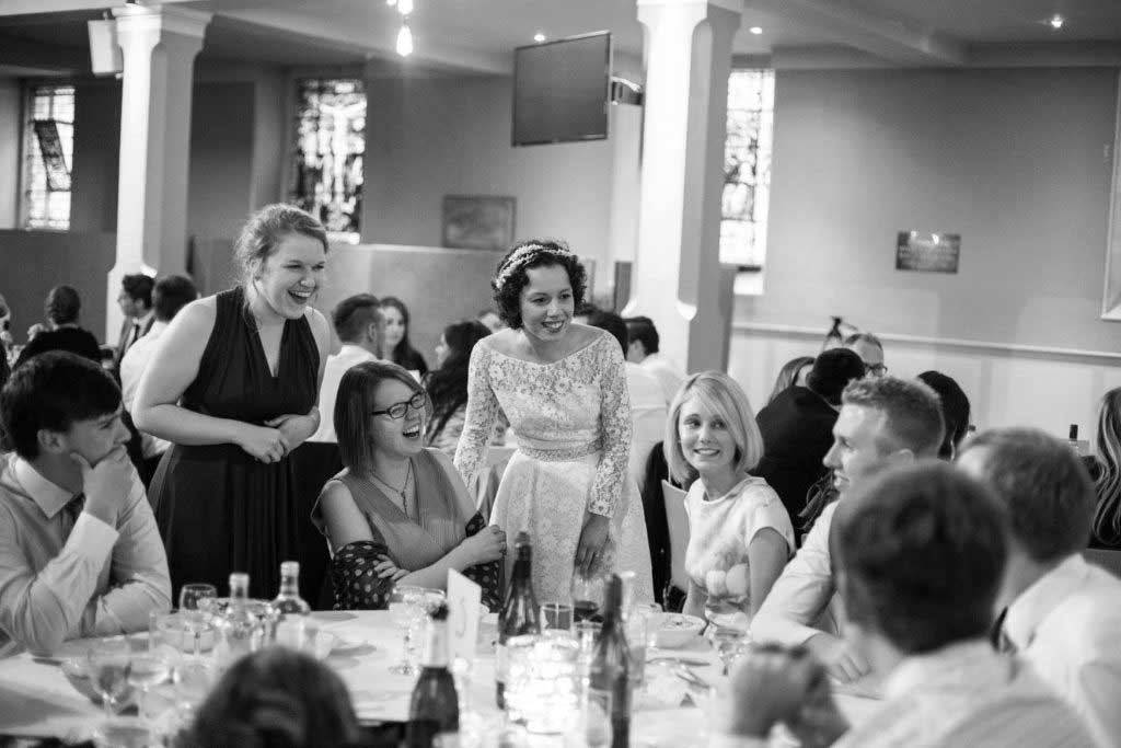 black and white, bride talks to her guest at wedding reception at St Mary's Venue Hire, London