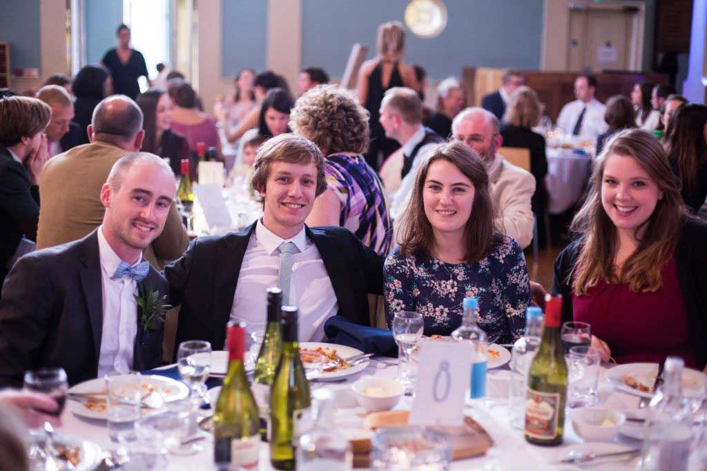 Smiling guests enjoying wedding meal at St Mary's Venue Hire, London