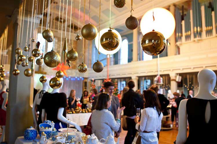 Gold hanging baubles in the auditorium at St Mary's Venue Hire, London