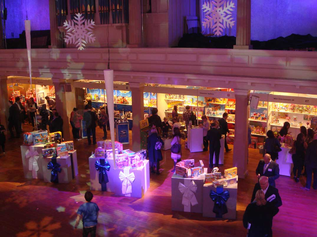 purple event lighting and hanging christmas decorations at dream toys product launch