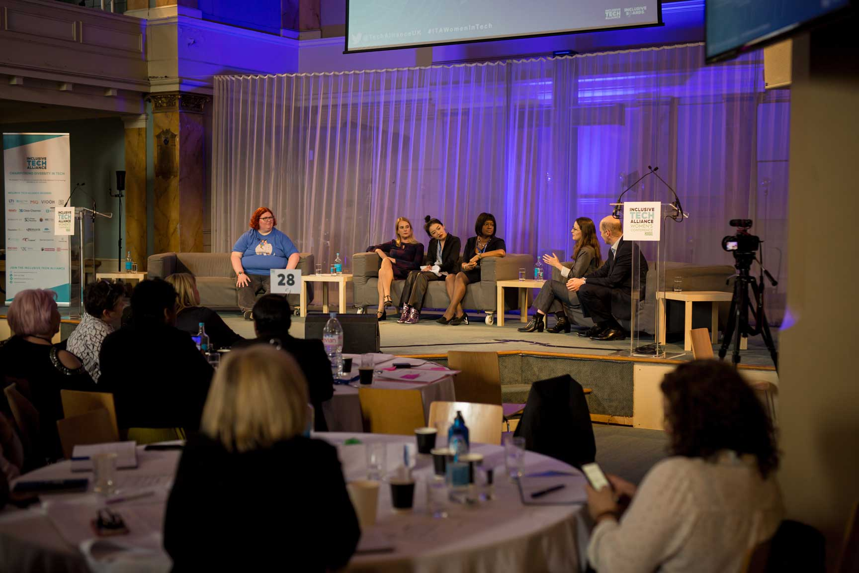 Panel of speakers at conference at Conference with screens and sofa style seating at St Mary's Venue Hire, London