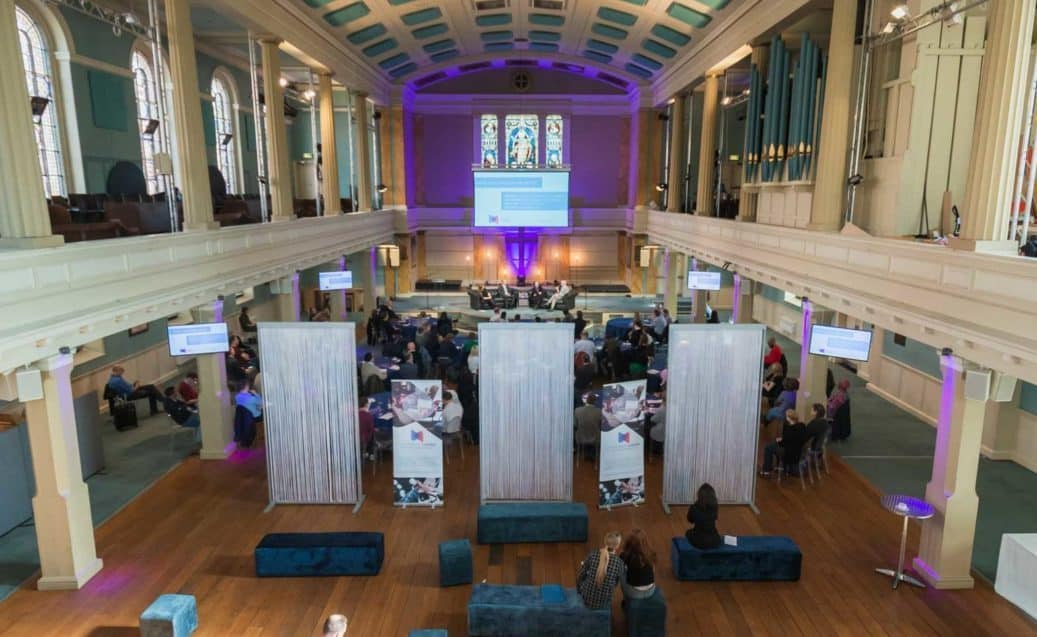 Conference with screens and sofa style seating at St Mary's Venue Hire, London