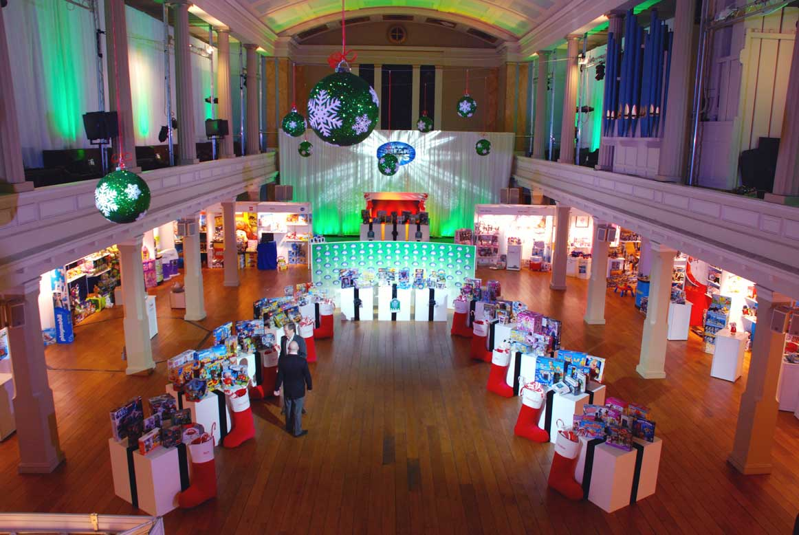 green event lighting and hanging christmas decorations at dream toys product launch