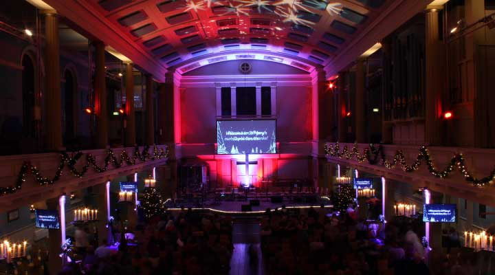 atmospheric lighting at Christmas decorations at carol concert at St Mary's Venue Hire, London