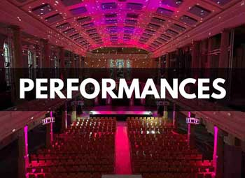 Theatre style layout with built out stage and pink lighting at St Mary's Venue Hire, London