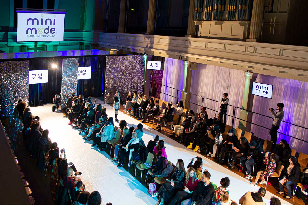 Double runway for a fashion show with glitter board and event lighting at St Mary's Venue Hire, London