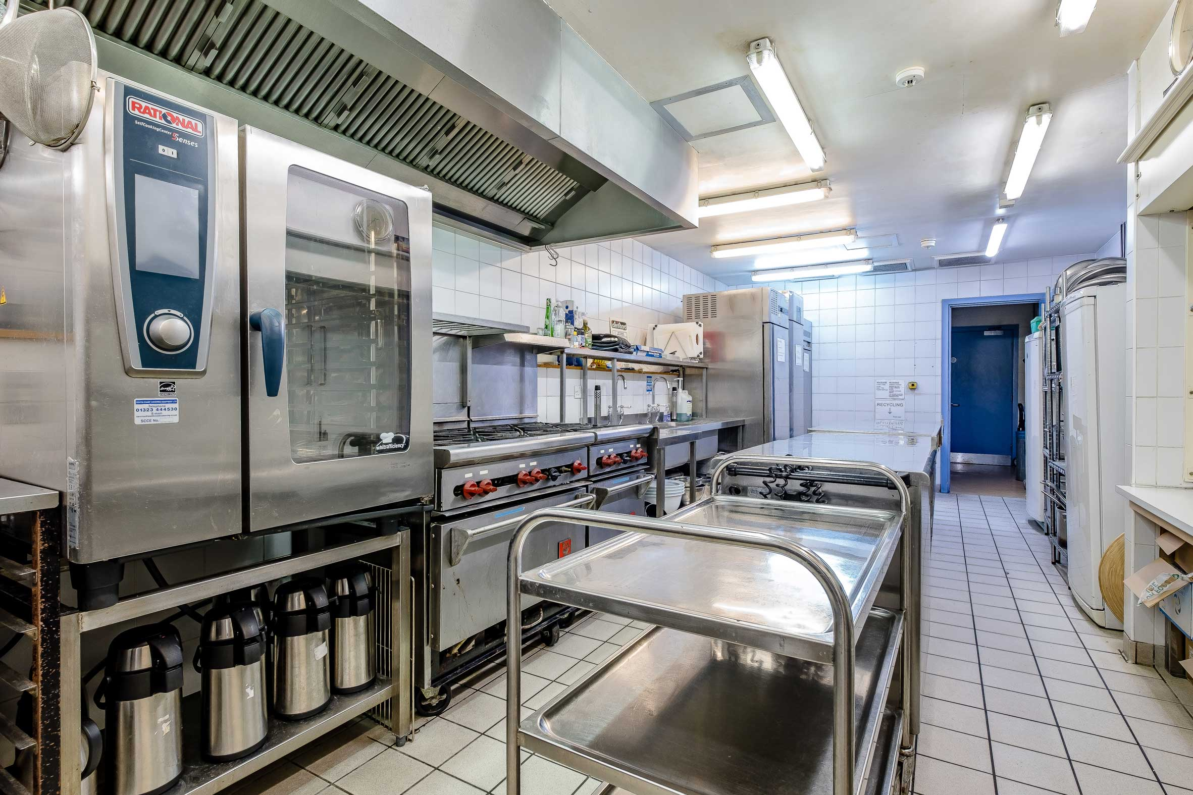 Fully commercial kitchen with ovens, hobs , fridge, freezer and dishwasher