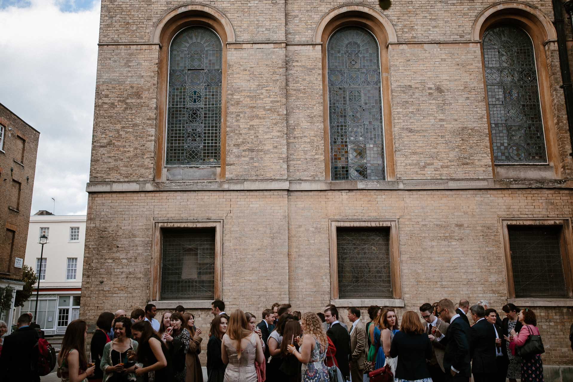 guest drinking on the piazza at a wedding reception outside St Mary's Venue Hire, London