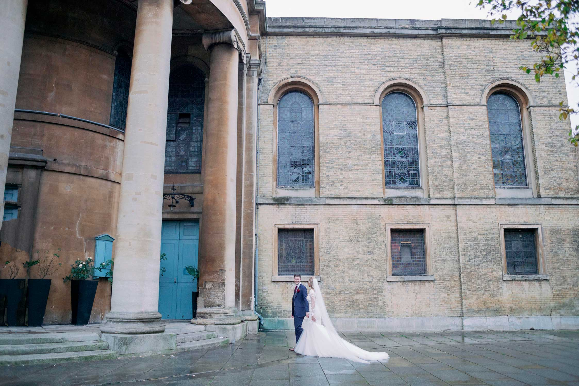 Bride and Groom on the piazza at their wedding