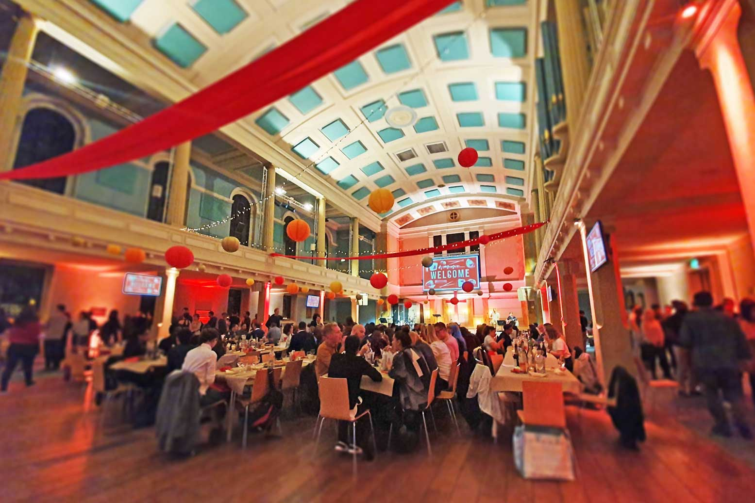 banquet style dining with streamers and fairy lights at St Mary's London Venue Hire