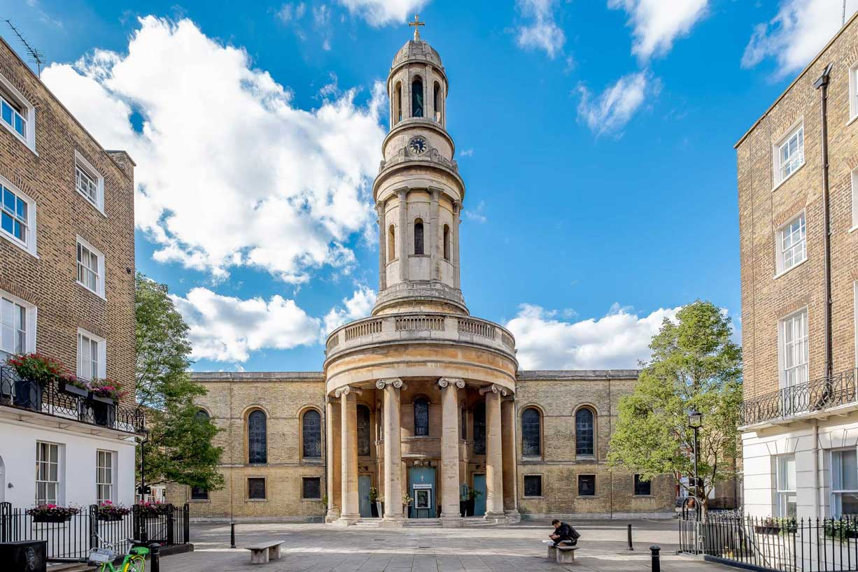 St Mary's London exterior and piazza with blue sky and clouds