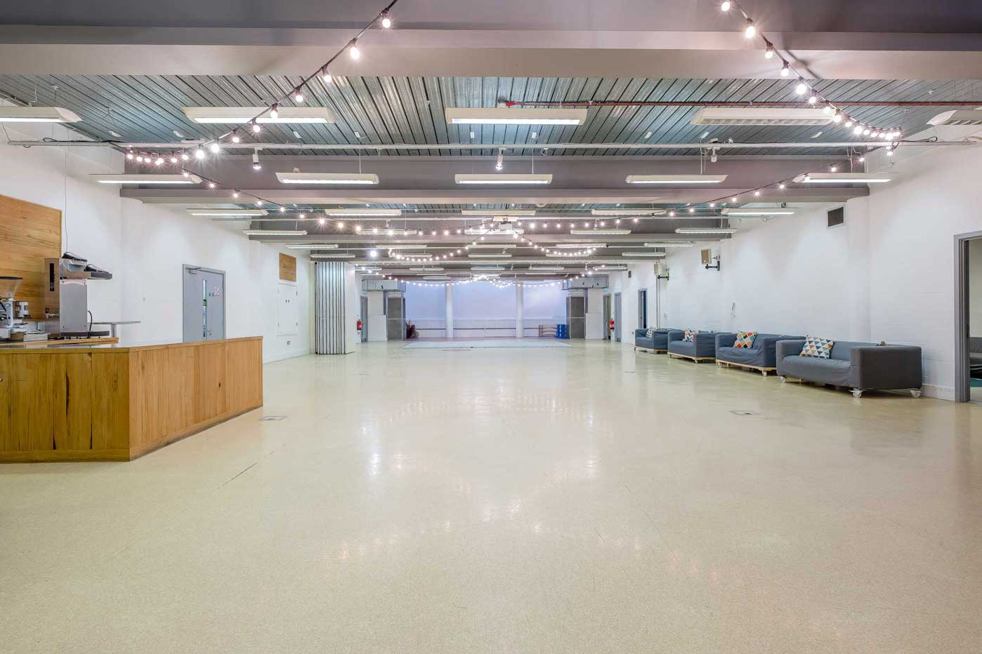 Lower Floor of St Mary's Venue Hire with coffee bar, meeting rooms and festoon lighting