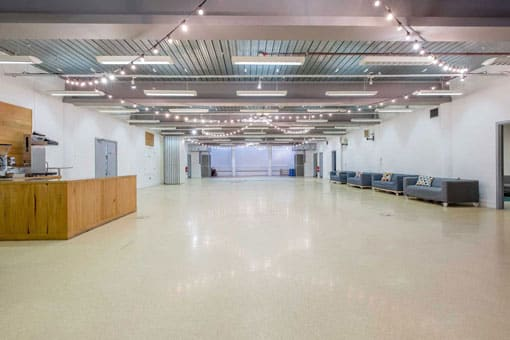 smaller image of Lower Floor of St Mary's Venue Hire with coffee bar, meeting rooms and festoon lighting