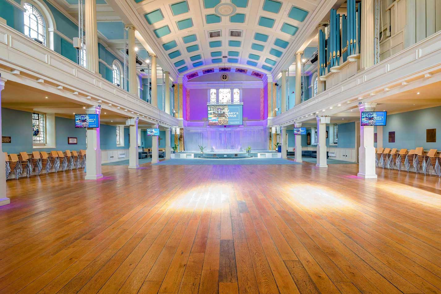 image of the main auditorium at St Mary's Venue Hire from back door showing the hall, organ and main stage