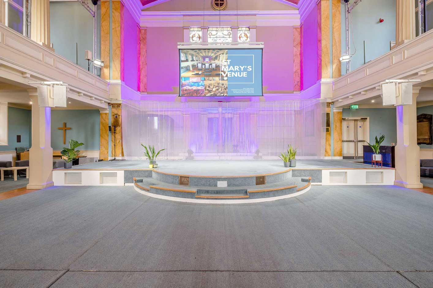 image of the main auditorium at St Mary's Venue Hire with the main stage and alcove lighting