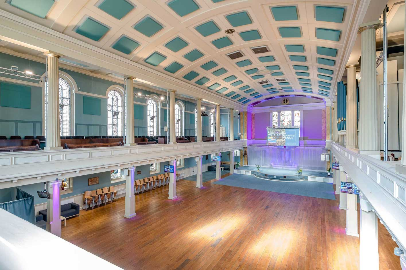 image of the main auditorium at St Mary's Venue Hire from back balcony with alcove lighting