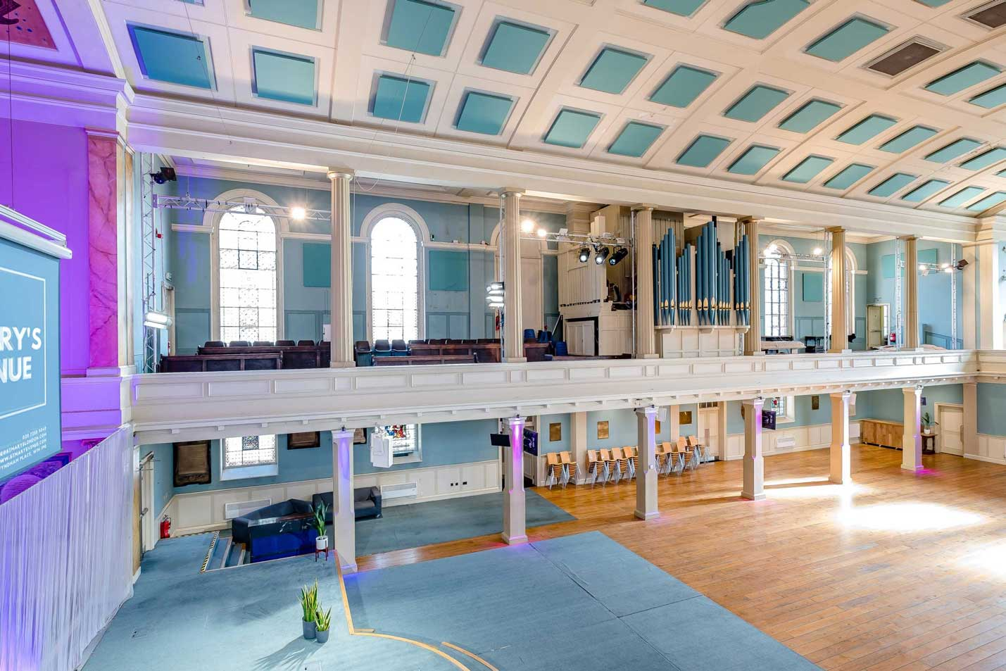 image of the main auditorium at St Mary's Venue Hire with balcony seating, organ, projector and stage