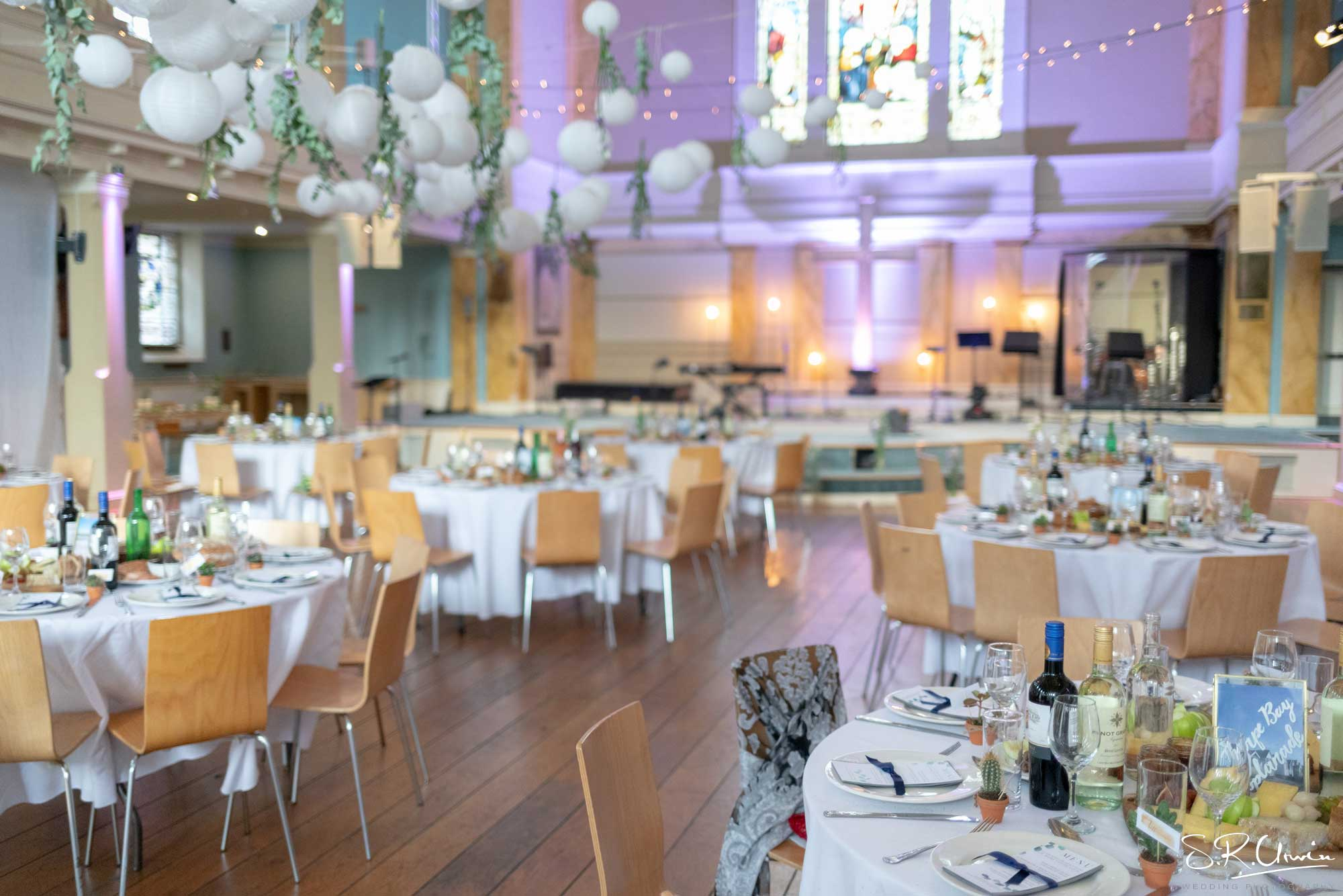 Cabaret Style wedding reception with hanging decor at St Mary's Venue Hire, London