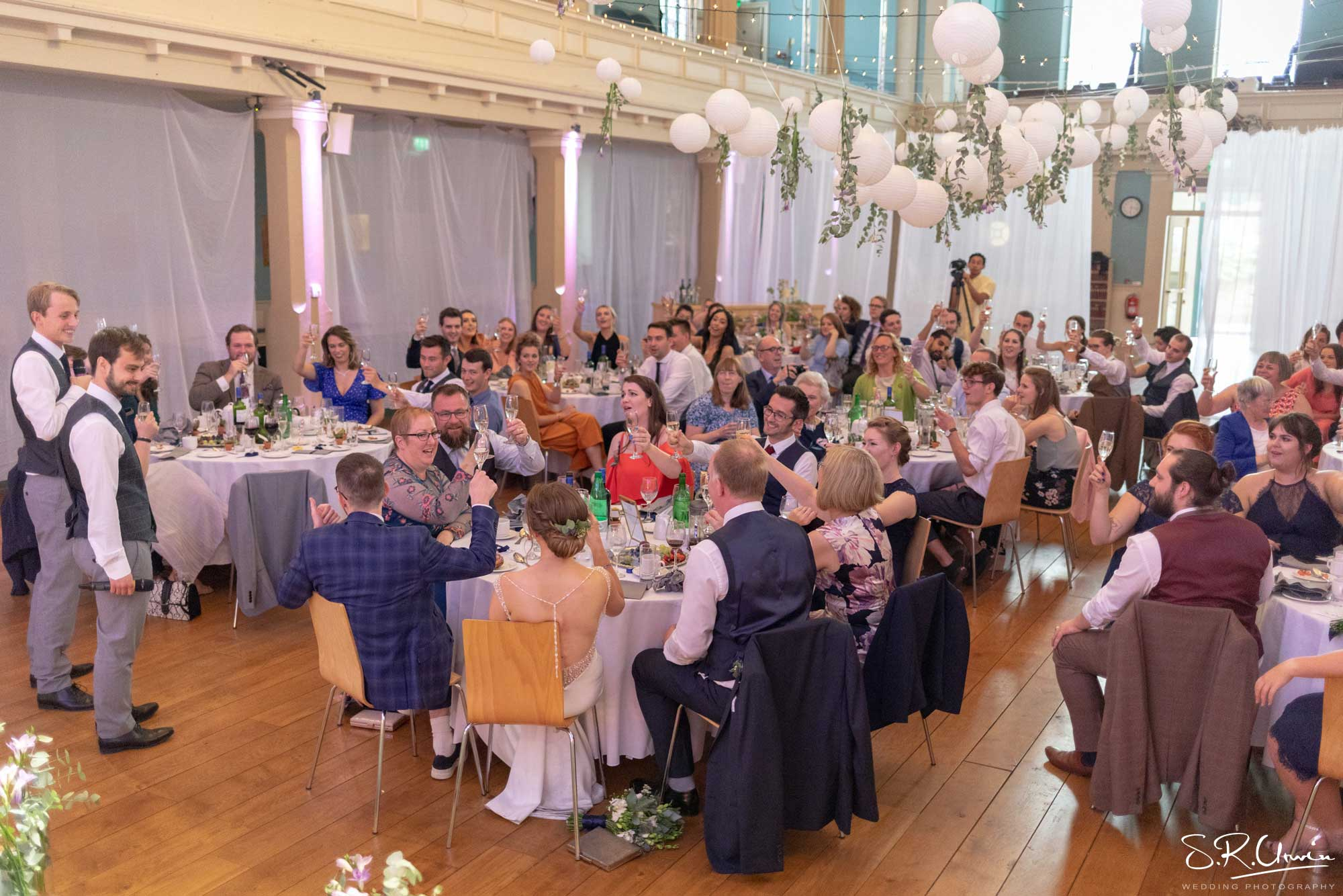 Cabaret Style wedding reception with hanging decor and drapes at St Mary's Venue Hire, London