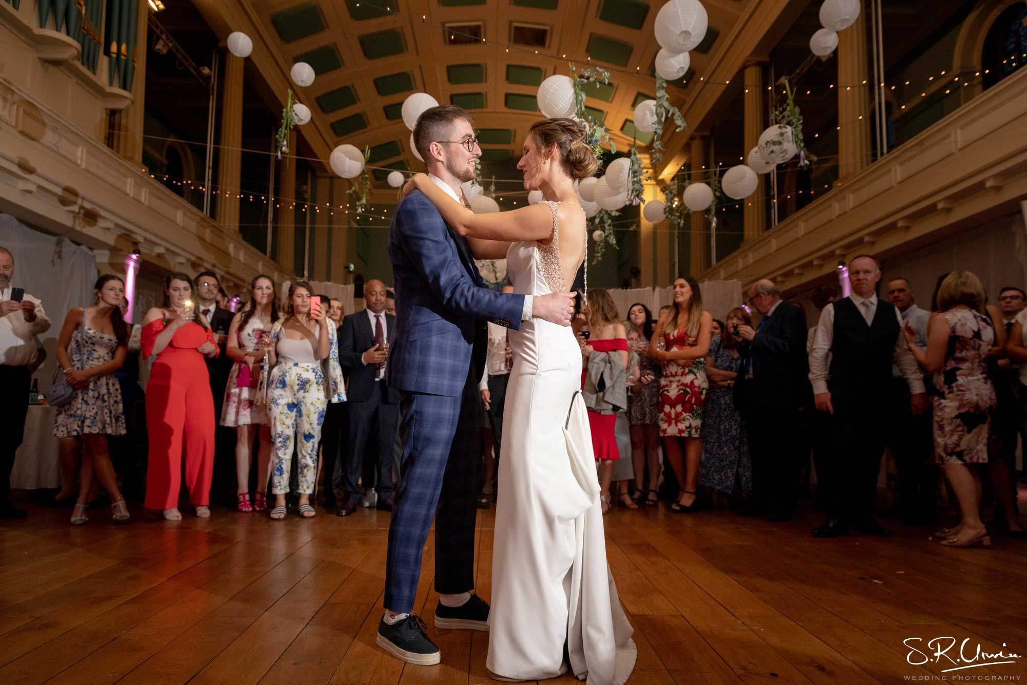 Bride and groom's first dance with watching guests at St Mary's Venue Hire, London