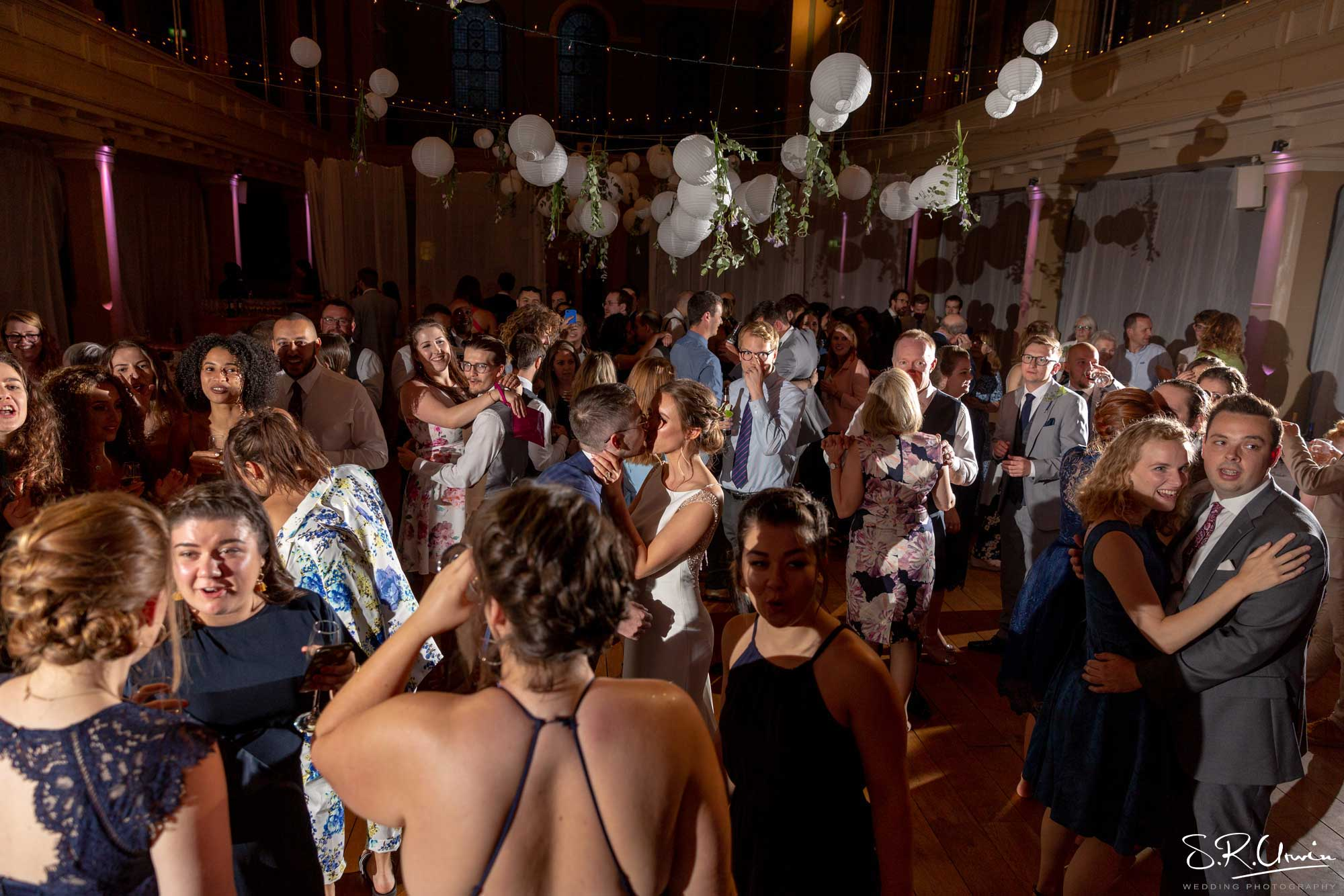 Dancing at wedding reception with hanging decor at St Mary's Venue Hire, London
