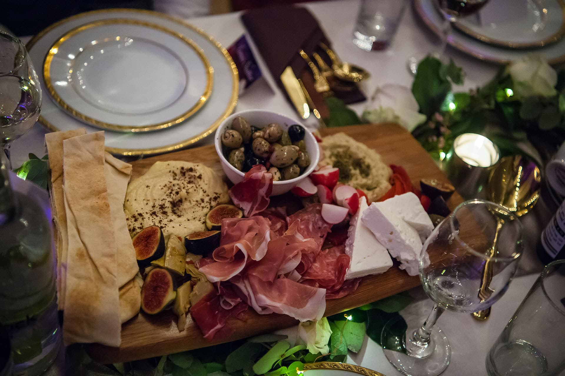 Wedding food platter with charcuterie, cheese and flatbread