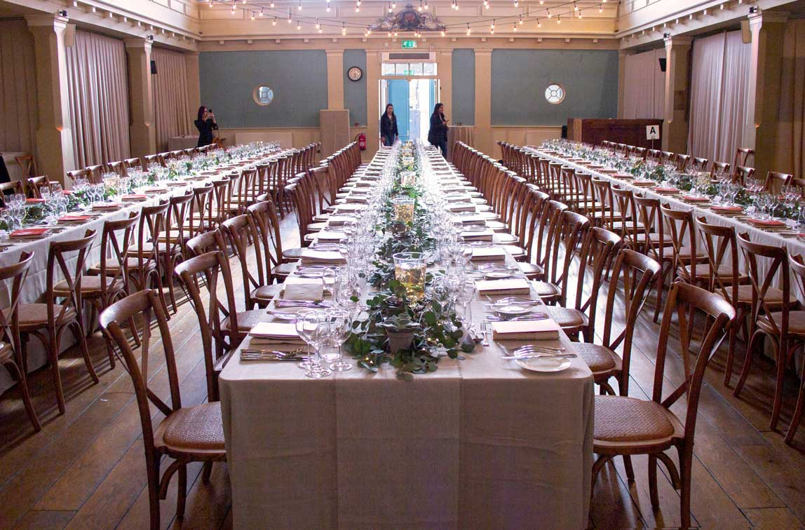 Banquet style dining with guests at St Mary's Venue Hire, London