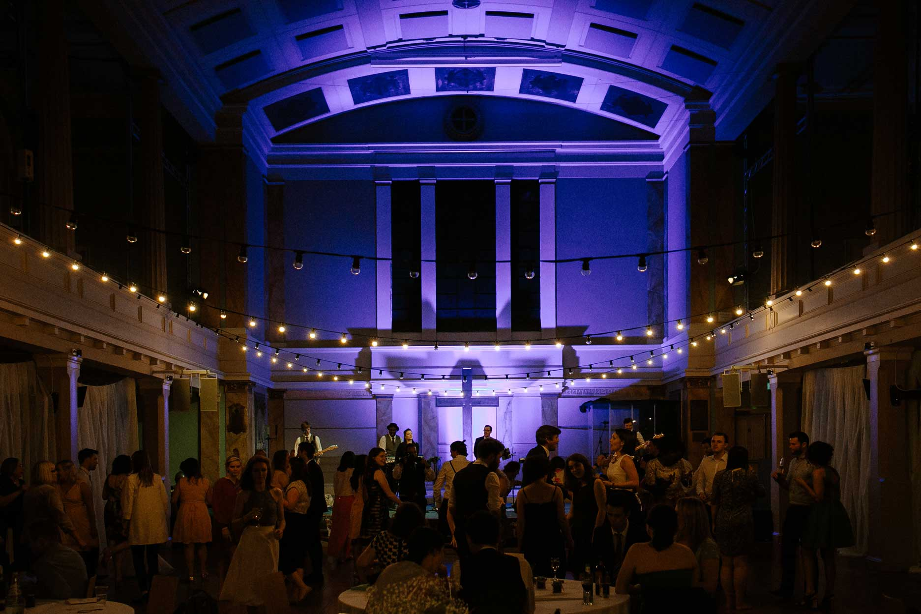 wedding reception with purple event lighting and festoons and dancing at St Mary's Venue Hire, London