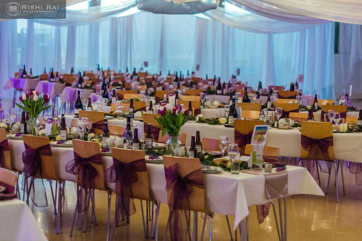 Dining tables at a wedding reception on St Mary's Lower Floor