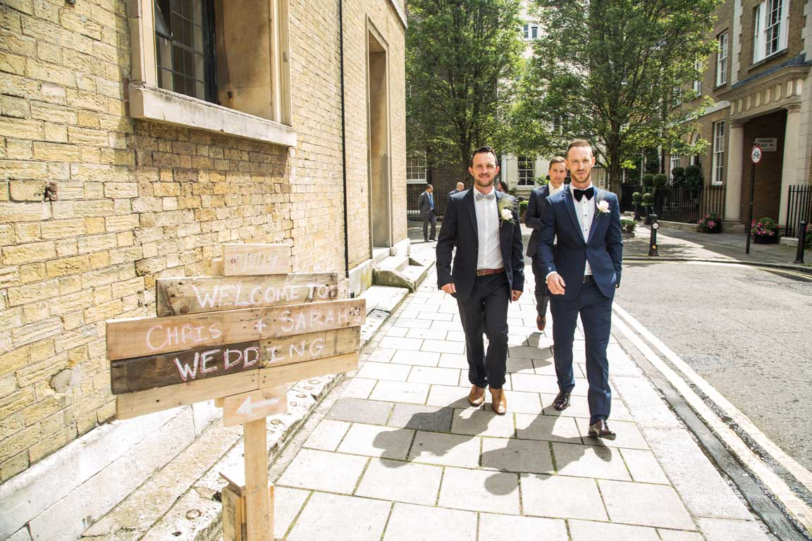 Groom and ushers on Wyndham Place outside the venue